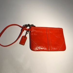 Coach Orange Patent Leather Wristlet